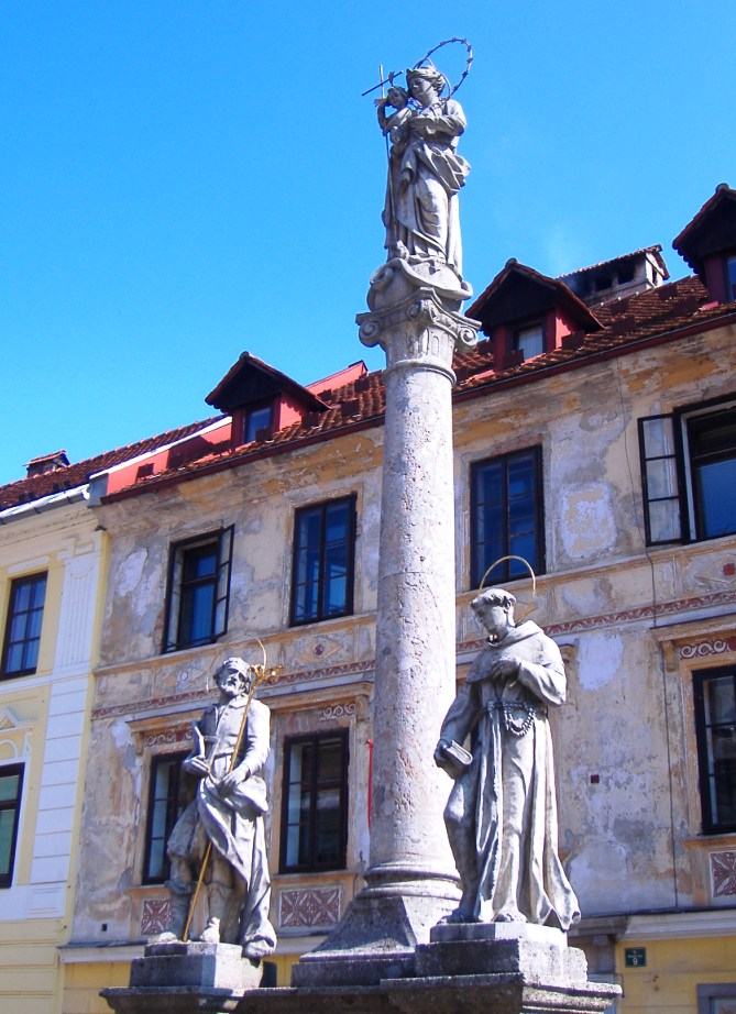 The plague pillar, in the center of Mestni trg (Škofja Loka's main square), was erected in 1751