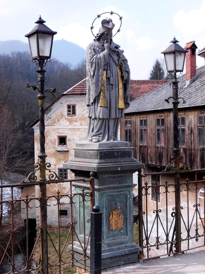 Statue of Saint John of Nepomuk - situated on the 14th Century Stone Capuchin Bridge
