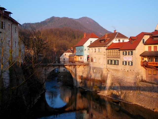 Classic edge of old town panorama: with the 14th Century Stone Capuchin's bridge--and the Hotel Garni Paleta-with rooms overlooking the Selška Sora river